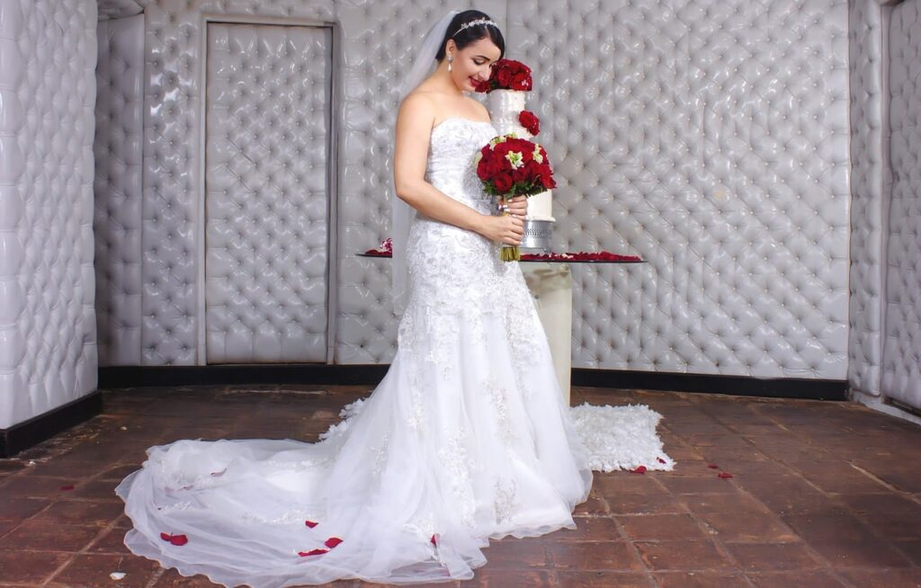Wedding Photography Posing - Admiring the wedding dress